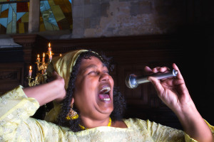 Closeup of a mature gospel or soul singer in a dark church